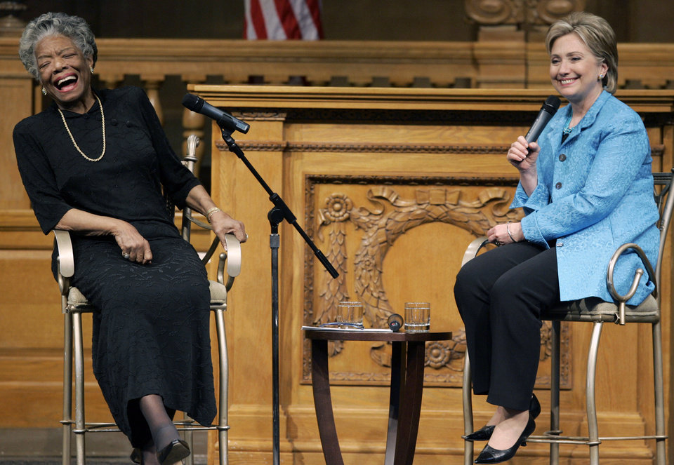Photo - FILE - In this April 18, 2008 file photo, then U.S. Sen. Hillary Rodham Clinton, D-N.Y., right, speaks as poet Maya Angelou reacts during a campaign stop at Wake Forest University in Winston-Salem, N.C. Angelou, who rose from poverty, segregation and violence to become a force on stage, screen and the printed page, has died, Wake Forest University said Wednesday, May 28, 2014.  She was 86.  (AP Photo/Chuck Burton, File)
