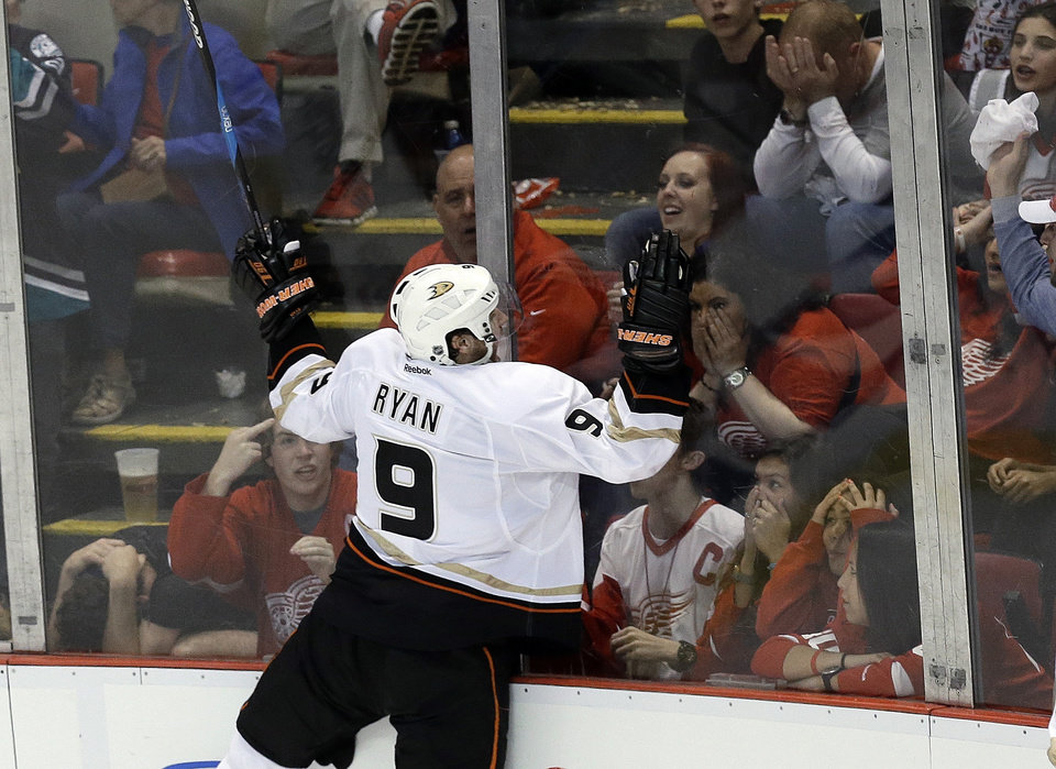 Photo - Anaheim Ducks right wing Bobby Ryan (9) celebrates his goal against Detroit Red Wings goalie Jimmy Howard in the third period in Game 6 of a first-round NHL hockey Stanley Cup playoff series in Detroit, Friday, May 10, 2013. (AP Photo/Paul Sancya)