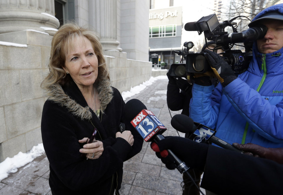 Former polygamist Kristyn Decker speaks with reporters before a hearing on whether Utah can prohibit plural marriage, Thursday, Jan. 17, 2013, in Salt Lake City. (AP Photo/Rick Bowmer)