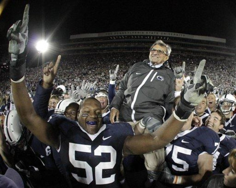 Penn State coach Joe Paterno is carried off the field  by his players after getting his 400th collegiate win, defeating Northwestern 38-21  in an NCAA college football game in State College, Pa., Saturday, Nov.l  6, 2010.  (AP Photo/Gene J. Puskar)