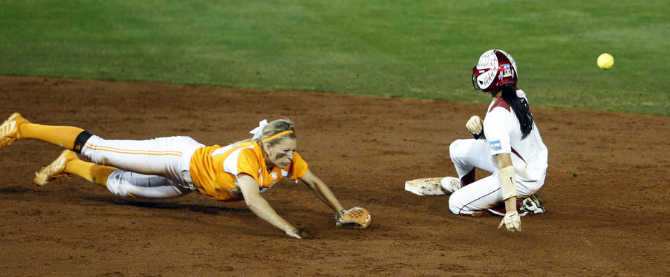 Photo - Oklahoma's Destinee Martinez is safe at second on a Tennessee error as the University of Oklahoma Sooner (OU) softball team plays Tennessee in the first game of the NCAA super regional at Marita Hynes Field on May 23, 2014 in Norman, Okla. Photo by Steve Sisney, The Oklahoman