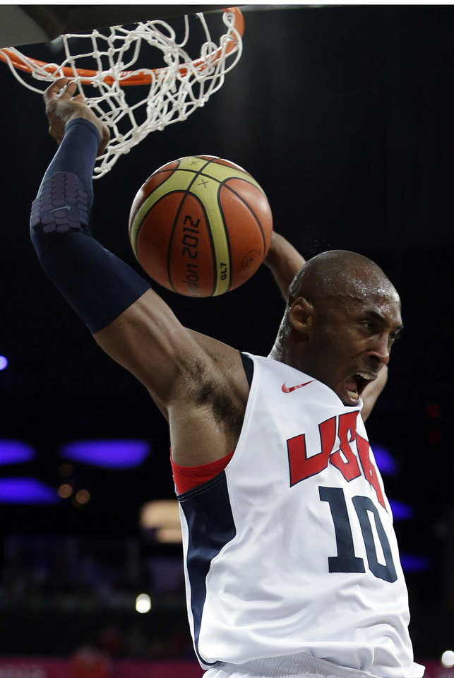 Photo - United States' Kobe Bryant reacts after a dunk during a men's gold medal basketball game against Spain at the 2012 Summer Olympics, Sunday, Aug. 12, 2012, in London. (AP Photo/Eric Gay)