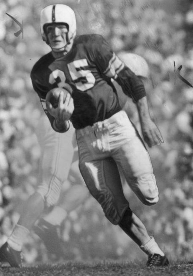 Photo -  Billy Vessels was so good for Bud Wilkinson's OU teams in the early 1950s, that he made his opponents disappear (that or there's some old-school photo editing). [OKLAHOMAN ARCHIVES]