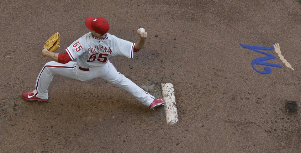 Photo - Philadelphia Phillies starting pitcher David Buchanan throws during the first inning of a baseball game against the Milwaukee Brewers Thursday, July 10, 2014, in Milwaukee. (AP Photo/Morry Gash)