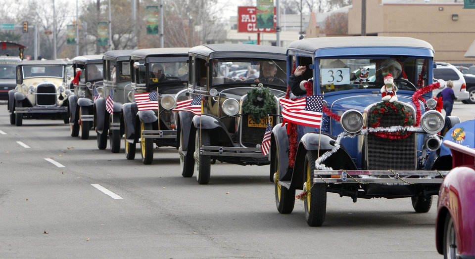 Members of the Okie-A's drive their model-A automobiles in the Stockyards City Christmas parade in Oklahoma City, OK, Saturday, December 1, 2012,  By Paul Hellstern, The Oklahoman