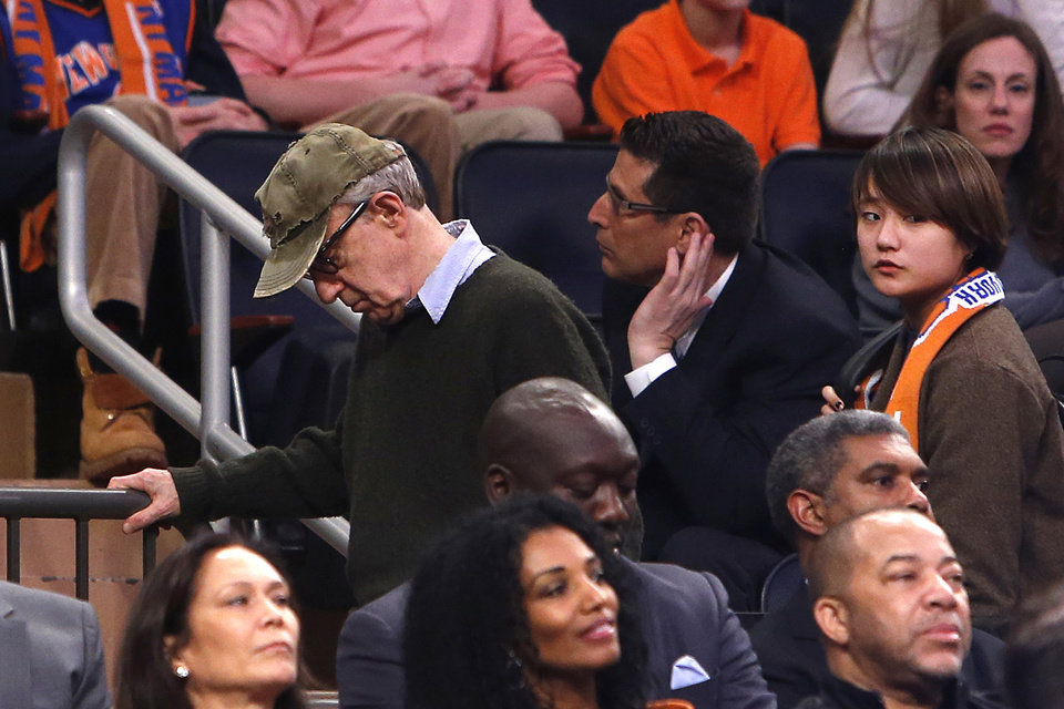 Photo - Filmmaker Woody Allen, left, leaves late in the fourth quarter of an NBA basketball game between the Miami Heat and the New York Knicks Saturday, Feb. 1, 2014, in New York.  Miami won 106-91. (AP Photo/Jason DeCrow)