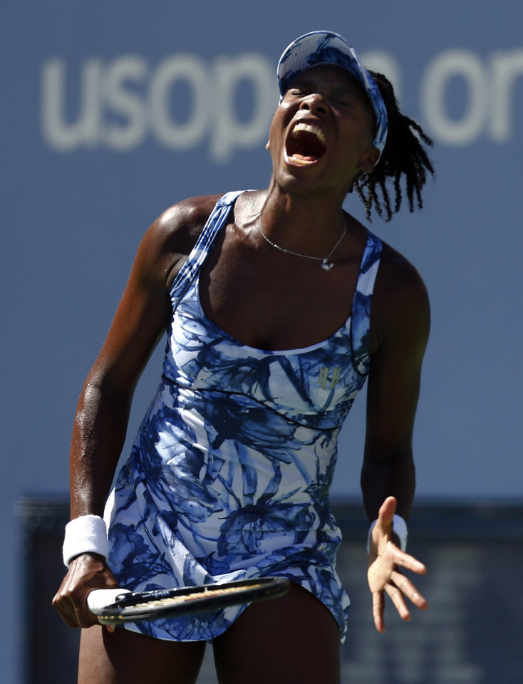 Photo - Venus Williams, of the United States, reacts after a shot against Sara Errani, of Italy, during the third round of the 2014 U.S. Open tennis tournament, Friday, Aug. 29, 2014, in New York. (AP Photo/Matt Rourke)