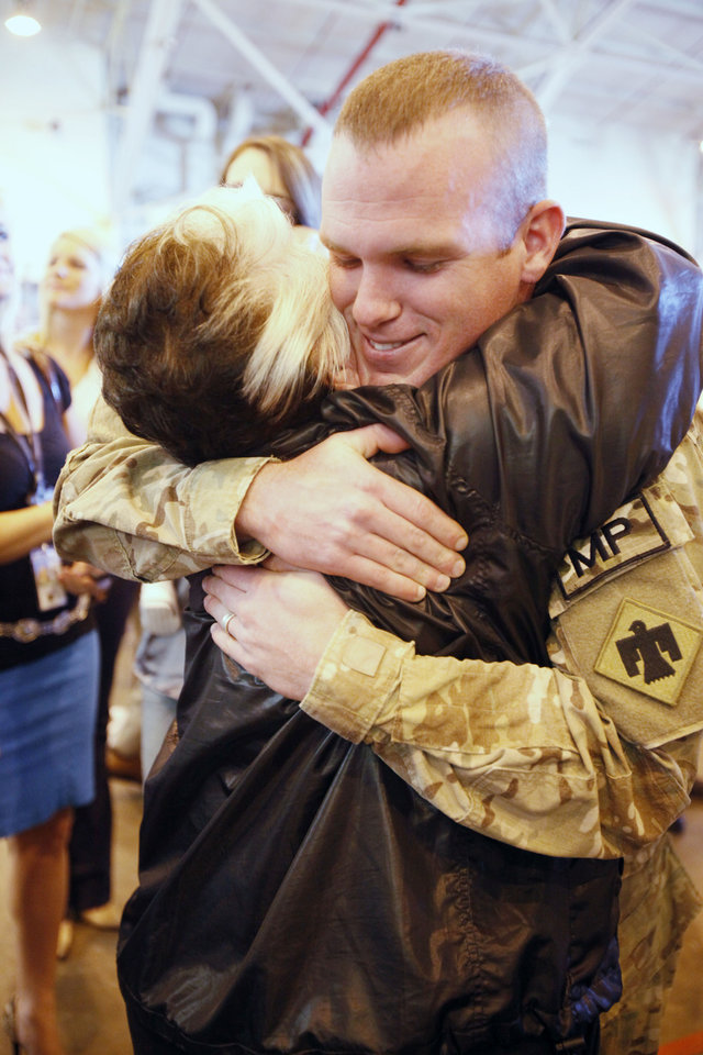 Photo - Cpl. Joseph English gets a hug from his grandmother Barbara English, as Oklahoma National Guard soldiers return from Afghanistan to a welcome home ceremony in Oklahoma City, OK, Tuesday, March 13, 2012,  By Paul Hellstern, The Oklahoman