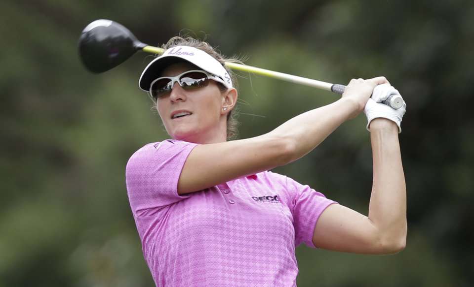 Photo - Brittany Lang watches her tee shot on the ninth hole during the second round of the LPGA Kingsmill Championship golf tournament at the Kingsmill resort in Williamsburg, Va., Friday, May 16, 2014. (AP Photo/Steve Helber)