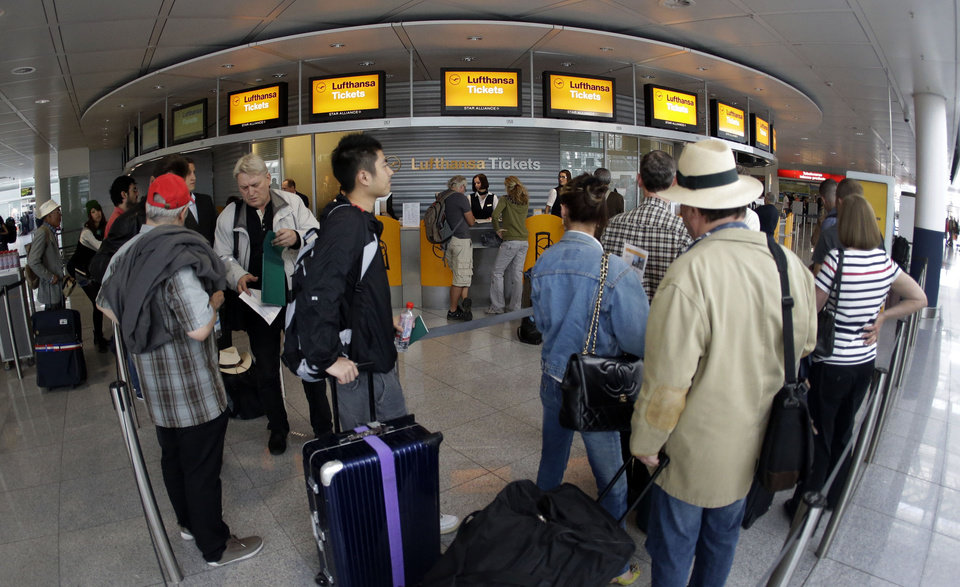 Photo -   Passengers wait in front of Lufthansa counters as flight attendants of German Lufthansa airline went on an 24-hour-strike for higher wages at the airport in Munich, southern Germany, on Friday, Sept. 7, 2012. (AP Photo/Matthias Schrader)