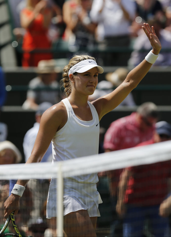 Photo - Eugenie Bouchard of Canada celebrates defeating Angelique Kerber of Germany in their women's singles quarterfinal match at the All England Lawn Tennis Championships in Wimbledon, London, Wednesday, July 2, 2014. (AP Photo/Ben Curtis)