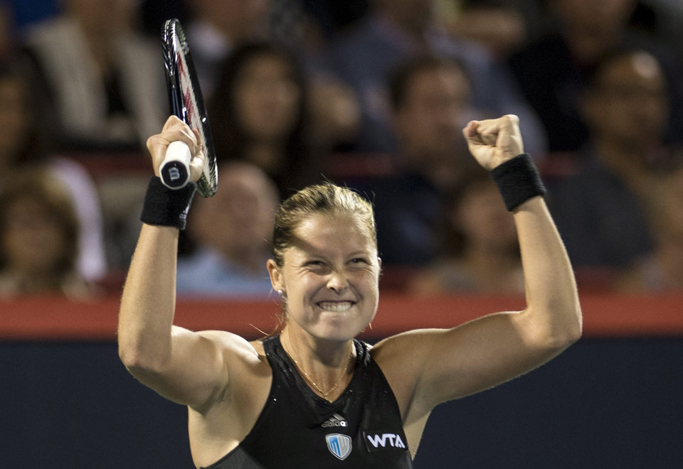 Photo - Shelby Rogers, of the United States, celebrates her 6-0, 2-6, 6-0 victory over Eugenie Bouchard, from Canada, at the Rogers Cup tennis tournament Tuesday, Aug. 5, 2014, in Montreal. (AP Photo/The Canadian Press, Paul Chiasson)