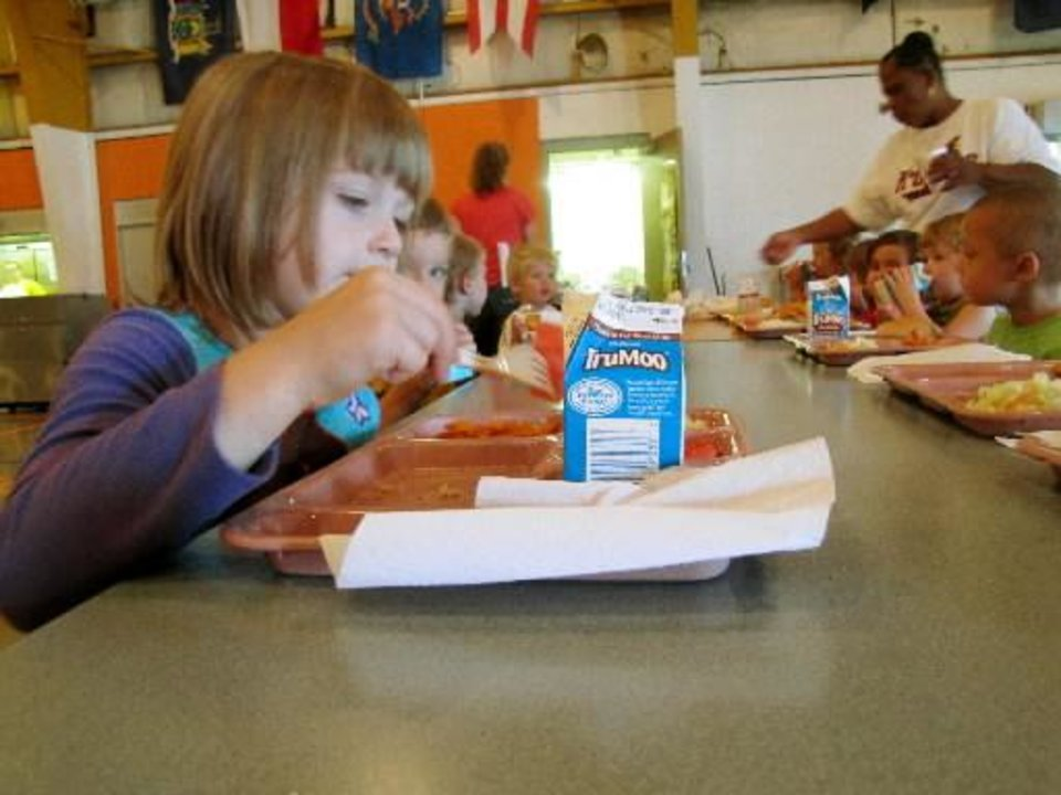 Photo - Kierri McCormick, 5, participates in the free summer lunch program at Wewoka Public Schools July 9, 2012. About 85 percent of students received free or reduced lunch last school year at Wewoka Public Schools. Photo by Sarah Boswell, The Oklahoman.
