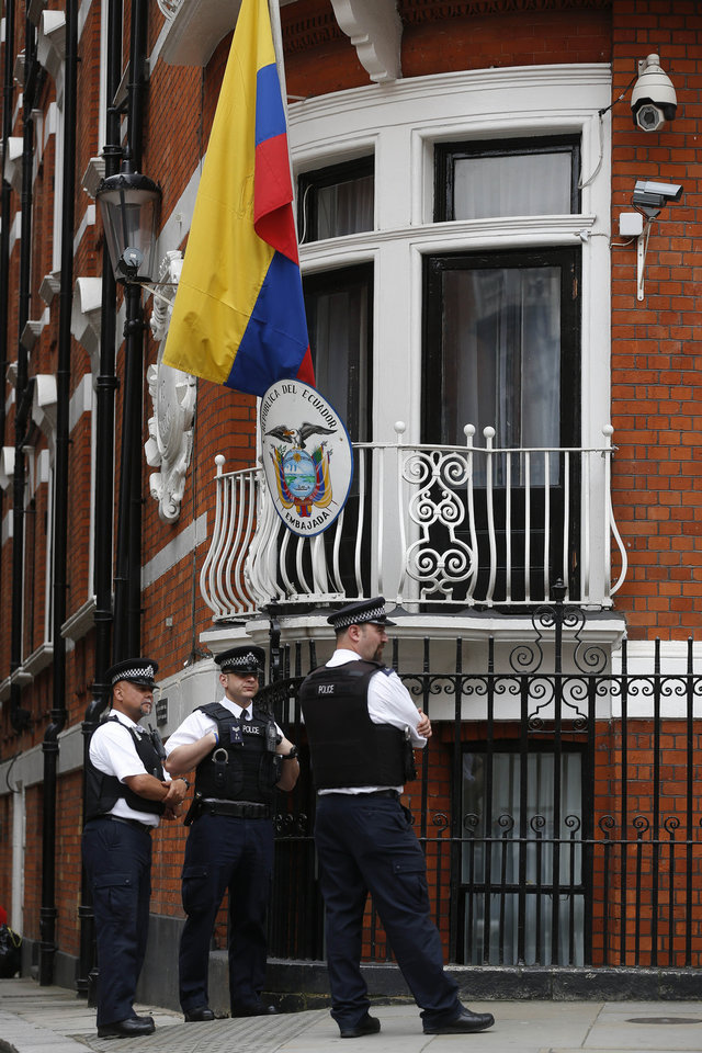 Photo - Police officers stand guard outside the Ecuadorian Embassy in London where WikiLeaks founder Julian Assange is in refuge at the embassy, Thursday, June 19, 2014. Julian Assange entered the embassy in June 2012 to gain political asylum to prevent him from being extradited to Sweden, where he faces allegations of sex crimes, which he denies.(AP Photo/Sang Tan)