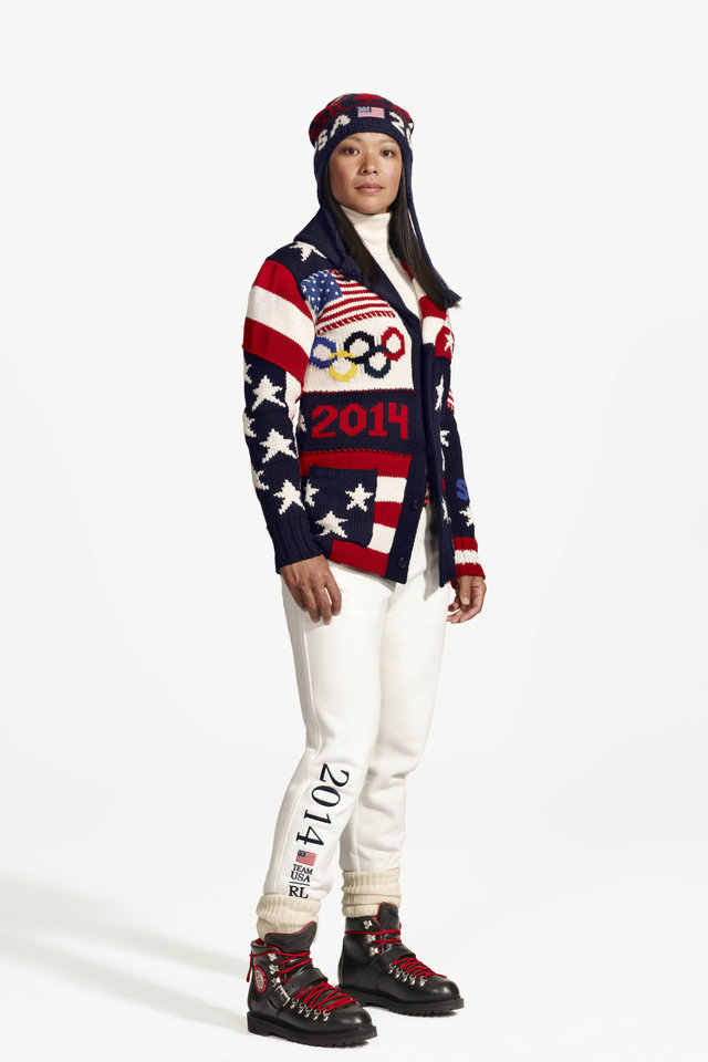 This product image released by Ralph Lauren shows American Olympic ice hockey player Julie Chu wearing the official uniform for Team USA to be worn at the  opening ceremony for the 2014 Winter Olympic games in Sochi, Russia. Every article of clothing made by Ralph Lauren for the U.S. Winter Olympic athletes in Sochi, including their opening and closing ceremony uniforms and their Olympic Village gear, has been made by domestic craftsman and manufacturers. (AP Photo/Ralph Lauren)