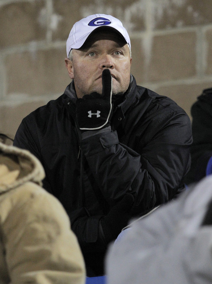 Photo - Guthrie Head Coach, Rafe Watkins, watches the game from the stands during a high school football game between Guthrie and East Central at The Rock in Guthrie, Friday, Nov. 18, 2011.  Photo by Garett Fisbeck, The Oklahoman