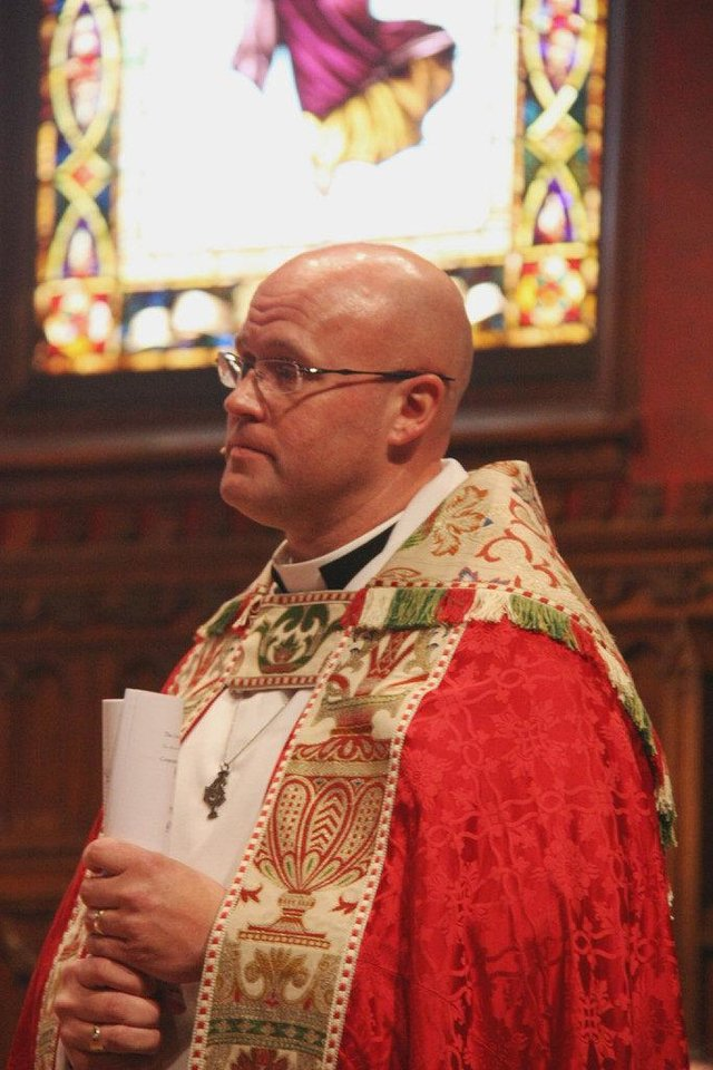 The Rev. Justin Lindstrom stands in the sanctuary of St. Paul's Episcopal Cathedral during his recent installation service at the downtown Oklahoma City church, 127 NW 7. Photo provided <strong></strong>