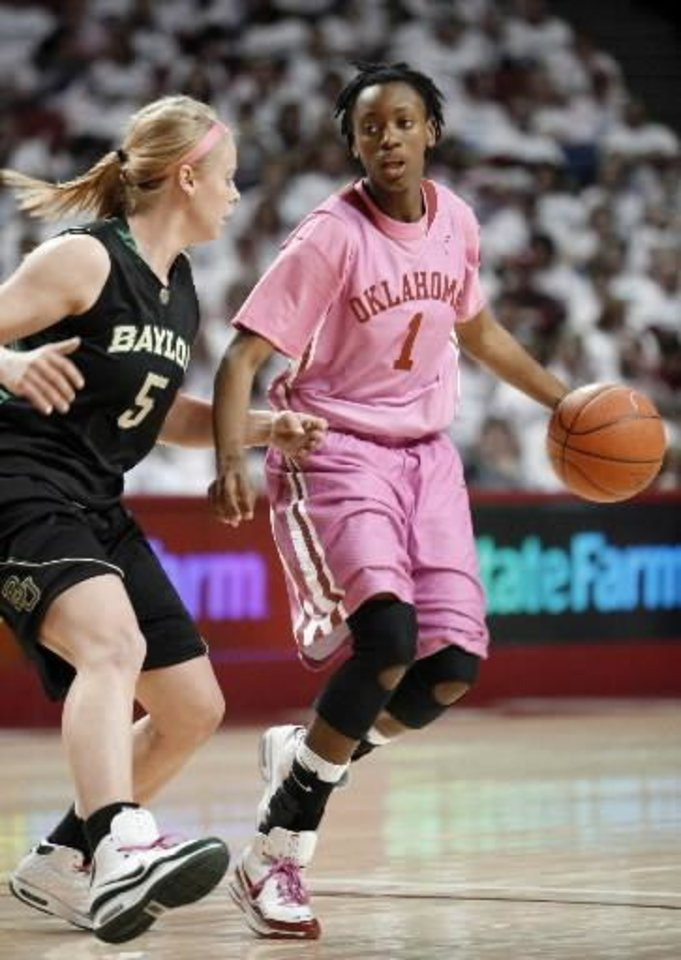 Photo - Nyeshia  Stevenson looks for an opening past Melissa Jones in the first half as the University of Oklahoma (OU) Sooner women play the Baylor Bears at the Lloyd Noble Center in Norman, Oklahoma, on Saturday February 21, 2009. Photo by Steve Sisney, The Oklahoman