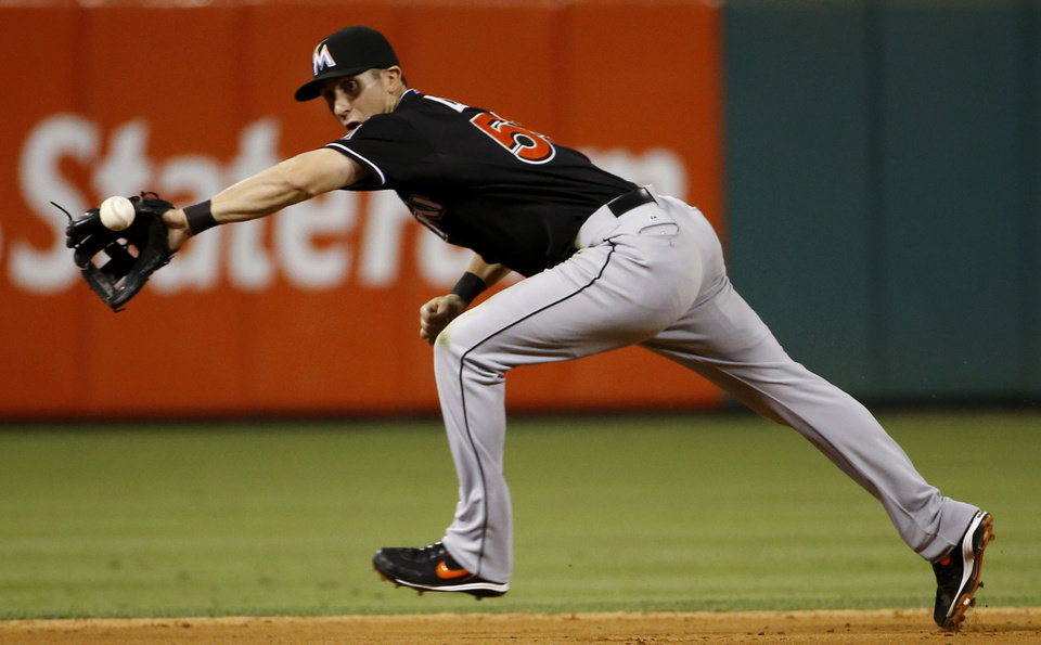 Photo - Miami Marlins shortstop Ed Lucas fields a double play hit by Philadelphia Phillies' Carlos Ruiz during the eighth inning of a baseball game, Monday, June 23, 2014, in Philadelphia. Miami won 4-0. Cesar Hernandez was forced out at second base and Ruiz at first on the play. (AP Photo/Matt Slocum)