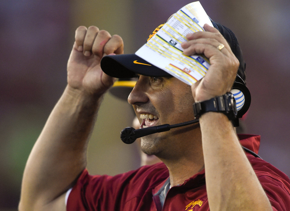 Photo - Southern California head coach Steve Sarkisian celebrates a touchdown during the second half of an NCAA college football game against Fresno State, Saturday, Aug. 30, 2014, in Los Angeles.  USC won 52-13. (AP Photo/Mark J. Terrill)