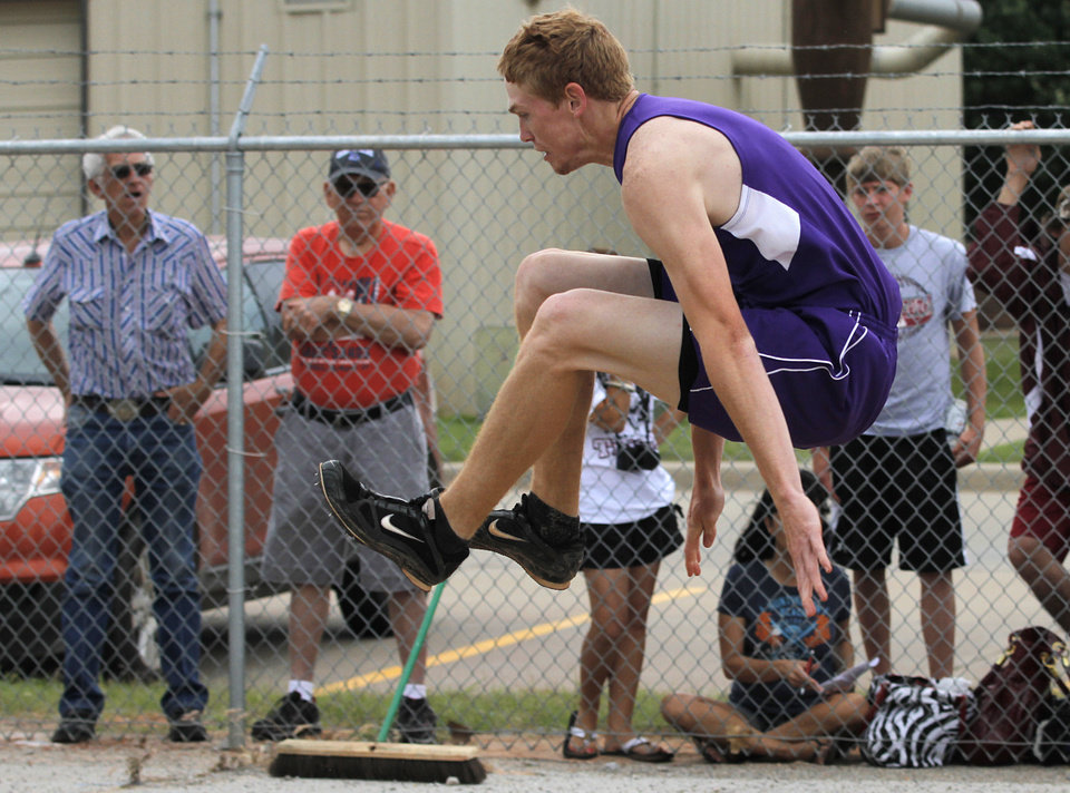 HIGH SCHOOL TRACK AND FIELD: Dillon Medford, of Elmore City, participates in boys 2A long jump during a track meet at Carl Albert High School in Midwest City, Friday, May 4, 2012.  Photo by Garett Fisbeck, For The Oklahoman
