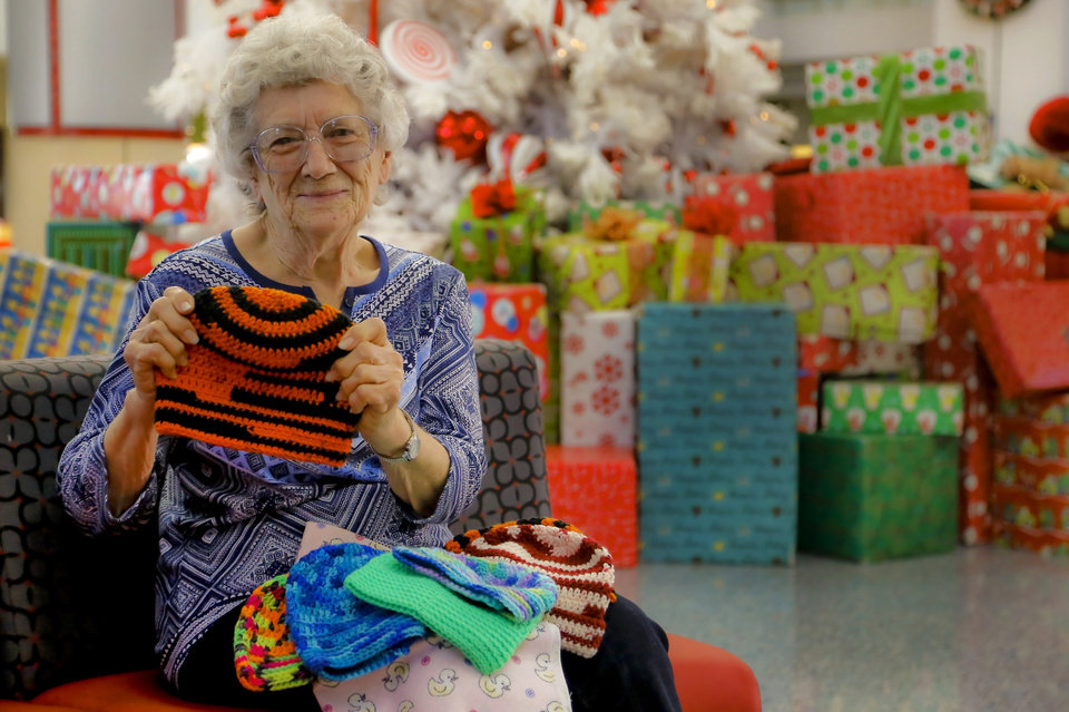 Photo -  Wanda Faye Campbell, 83, of Healdton, delivers more than 350 stocking caps she made for kids at The Children's Hospital at OU Medical Center on Monday in Oklahoma City. [Photo by Chris Landsberger, The Oklahoman]