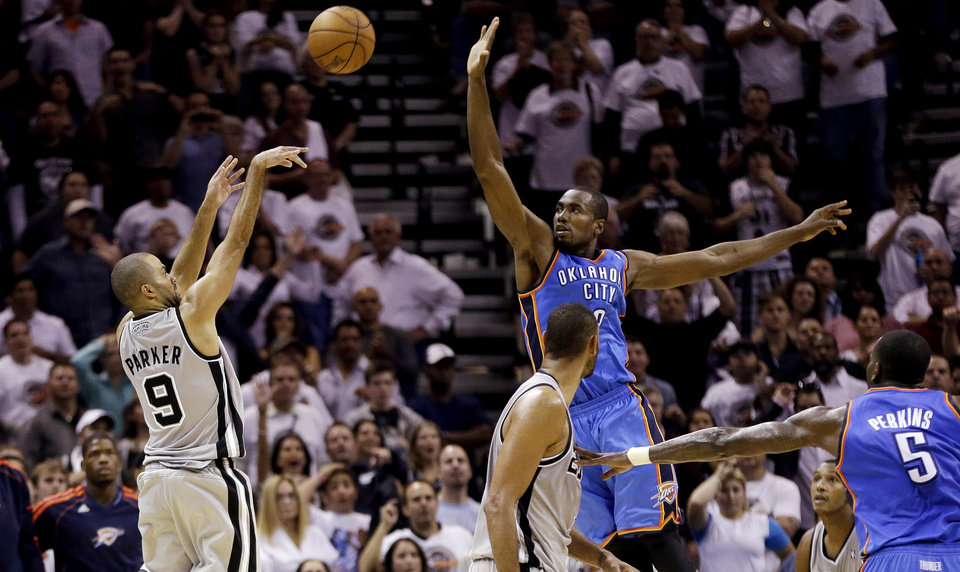 San Antonio Spurs\' Tony Parker (9), of France, shoots a buzzer-beating basket over Oklahoma City Thunder\'s Serge Ibaka, center, at the close of the fourth quarter of an NBA basketball game, Thursday, Nov. 1, 2012, in San Antonio. San Antonio won 86-84. Spurs\' Tim Duncan, second from left, and Oklahoma City\'s Kendrick Perkins (5) watch. (AP Photo/Eric Gay) ORG XMIT: TXEG115
