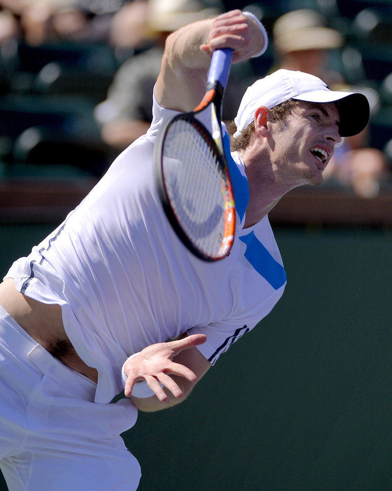 Photo - Andy Murray, of Great Britain, serves to Jiri Vesely, of Czech Republic, during a third round match at the BNP Paribas Open tennis tournament, Monday, March 10, 2014, in Indian Wells, Calif. (AP Photo/Mark J. Terrill)