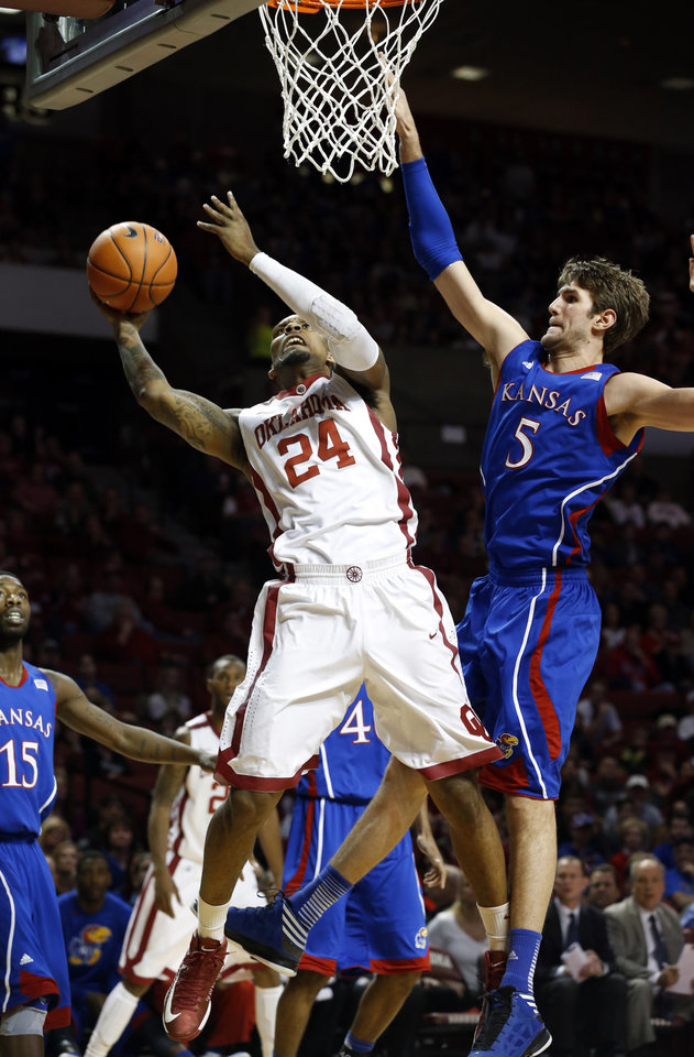 Romero Osby (24) shoots defended by Kansas' Jeff Withey (5) as the University of Oklahoma Sooners (OU) play the Kansas Jayhawks (KU) in NCAA, men's college basketball at The Lloyd Noble Center on Saturday, Feb. 9, 2013 in Norman, Okla. Photo by Steve Sisney, The Oklahoman