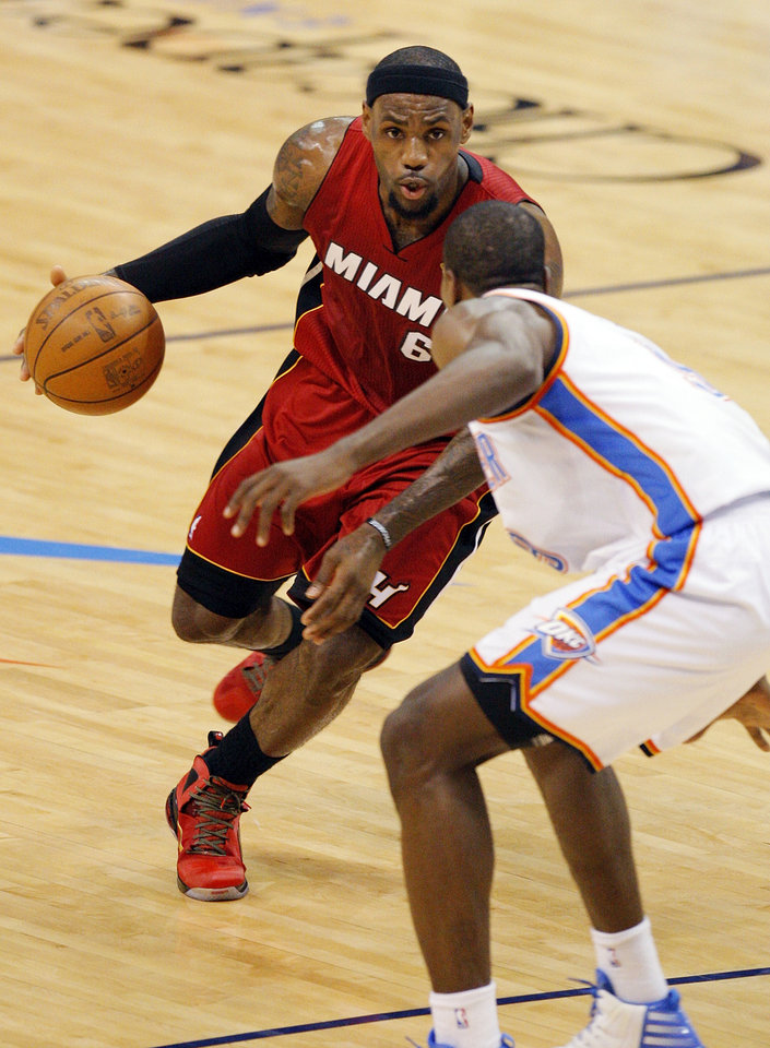 Miami's LeBron James (6) drives the ball on Oklahoma City's Serge Ibaka (9) during Game 1 of the NBA Finals between the Oklahoma City Thunder and the Miami Heat at Chesapeake Energy Arena in Oklahoma City, Tuesday, June 12, 2012. Photo by Nate Billings, The Oklahoman