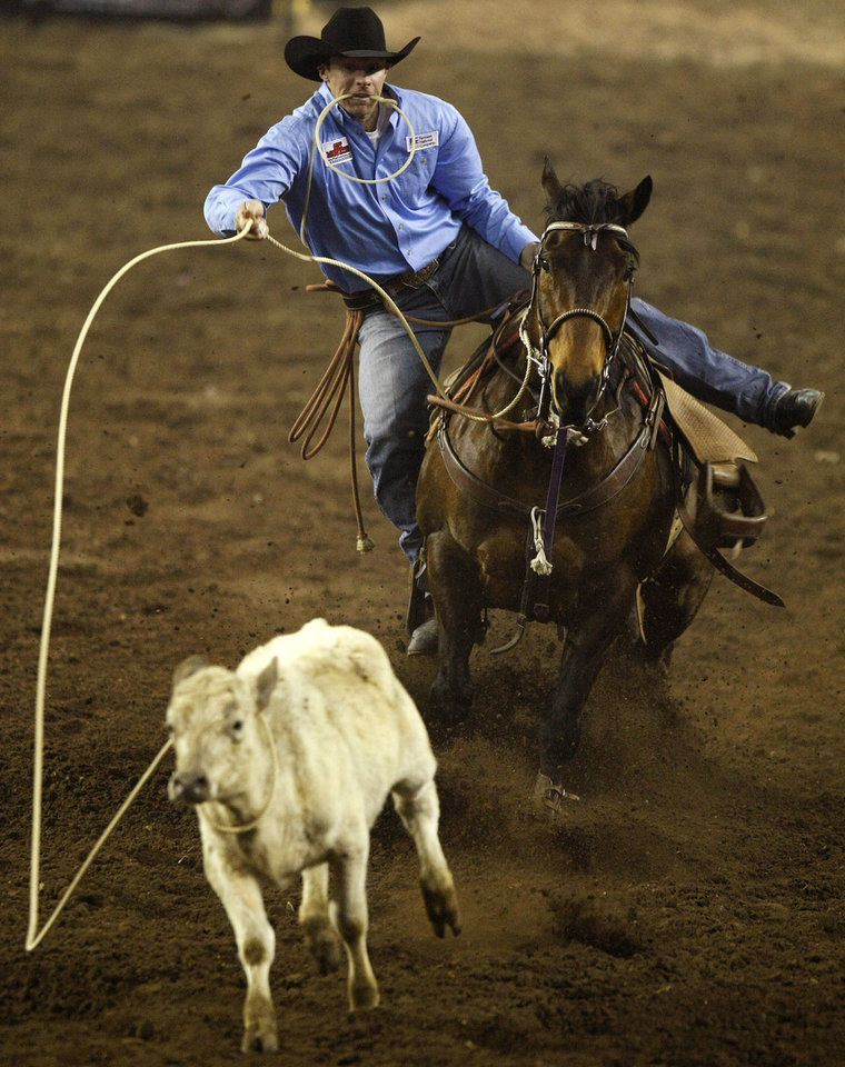 Jayce Johnson of Hemingford, Neb., competes in tie-down roping during the National Circuit Finals Rodeo at State Fair Arena in Oklahoma City, Thursday, March 29, 2012. Photo by Bryan Terry, The Oklahoman