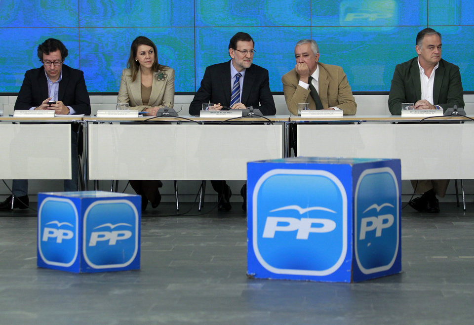 Photo - Spain's Prime Minister Mariano Rajoy, centre, Popular Party's General Vice-secretary, Javier Arenas Bocanegra, second right, and Popular Party's General Secretary, Dolores Cospedal, second left, and member of the Party gesture during a emergency meeting at the Popular Party headquarter in Madrid, Spain, Saturday, Feb. 2, 2013. Spain's governing Popular Party insists its financial accounts are totally legal and denies a newspaper report of regular under-the-table payments to leading members, including current Prime Minister Mariano Rajoy. The scandal first broke when after the National Court reported that former party treasurer Luis Barcenas amassed an unexplained euro 22 million ($30 million) in a Swiss bank account several years ago. In a statement Thursday Jan. 31, 2013, the party denied the existence of