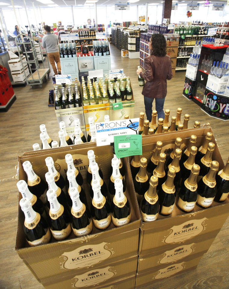 Thousands of bottles of Champagne and sparkling wine will be sold during the next several days at Byron's Liquor Warehouse for New Year's Eve. Photo by PAUL HELLSTERN, The Oklahoman