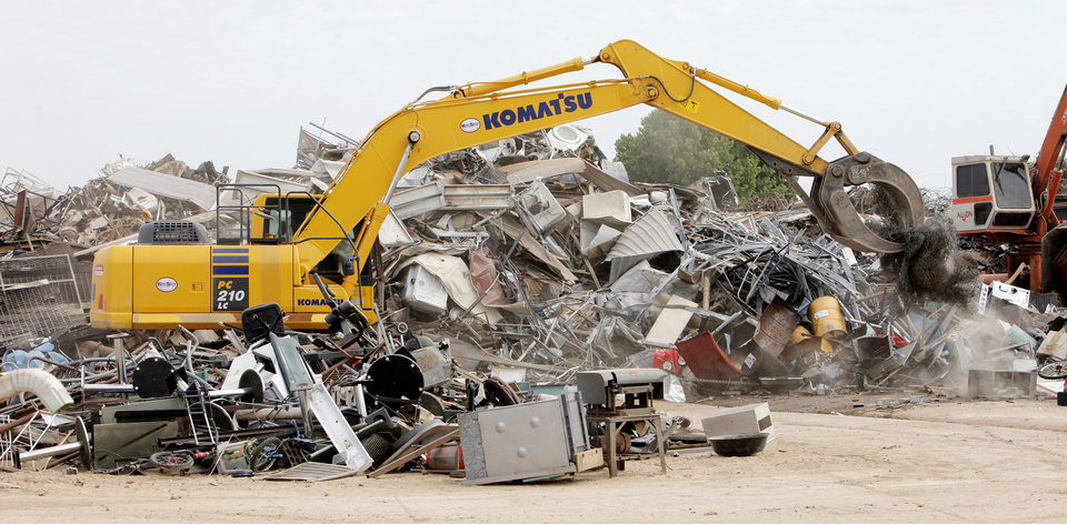 Photo -  A trackhoe sorts metal last week brought into Metal Check in south Oklahoma City Tuesday. Photo by Paul B. Southerland, The Oklahoman   PAUL B. SOUTHERLAND -  PAUL B. SOUTHERLAND