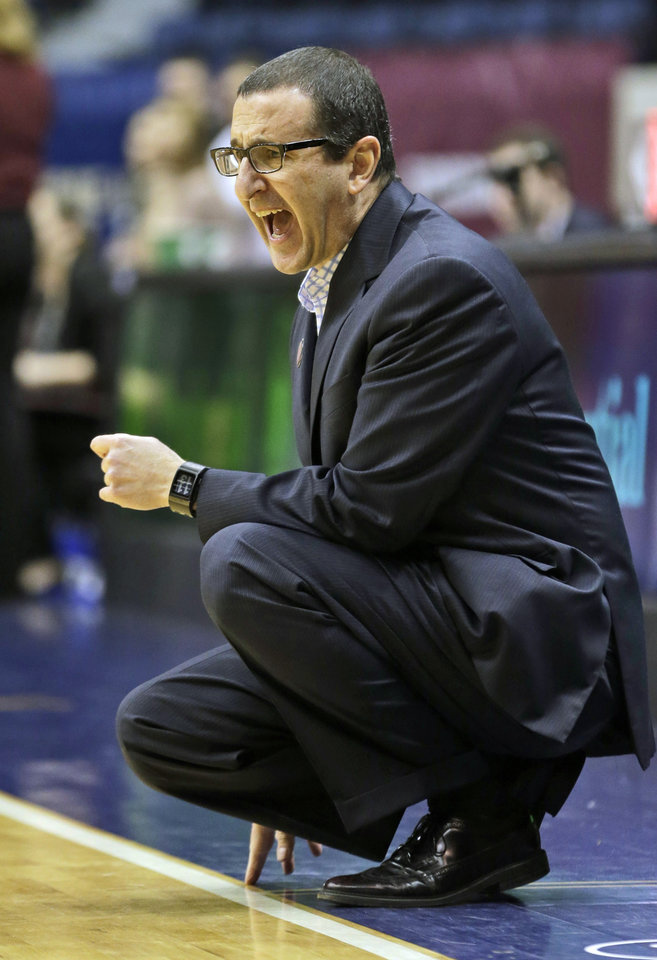 Photo - Dayton head coach Jim Jabir directs his team during the first half of the Atlantic 10 Conference college basketball championship game against Fordham in Richmond, Va., Sunday, March 9, 2014. (AP Photo/Steve Helber)