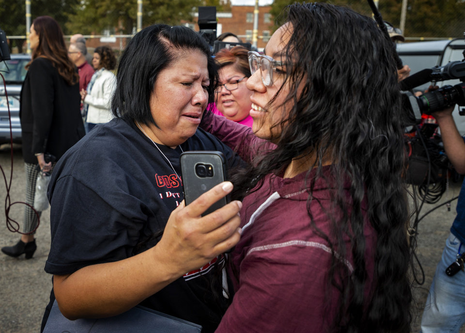 Photo - Tess Harjo, right, is embraced by her aunt Sarah Taylor after Harjo was released from the Dr. Eddie Warrior Correctional Facility on Monday, Nov. 4, 2019 in Taft, Okla. Governor Kevin Stitt greeted an estimated 70 women whose sentences he commuted from the facility. [Chris Landsberger/The Oklahoman]