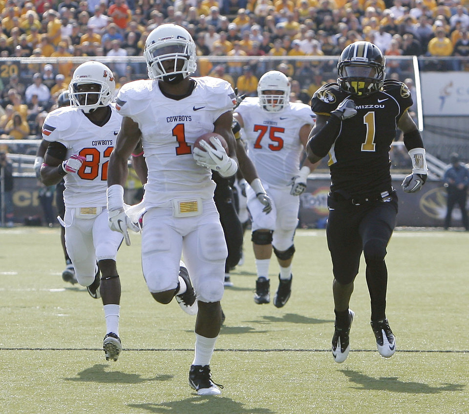 Photo - Oklahoma State's Joseph Randle (1) runs in for a touchdown as Missouri's Kip Edwards (1) chases him during a college football game between the Oklahoma State University Cowboys (OSU) and the University of Missouri Tigers (Mizzou) at Faurot Field in Columbia, Mo., Saturday, Oct. 22, 2011. Photo by Sarah Phipps, The Oklahoman