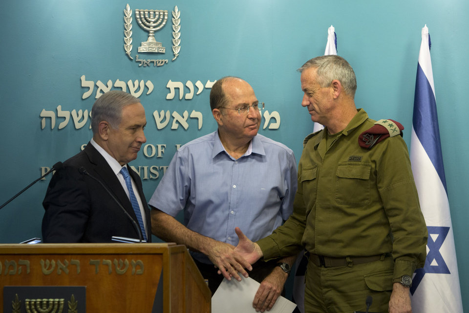 Photo - Israeli Prime Minister Benjamin Netanyahu, left, stands with Israel's Defense Minister Moshe Yaalon, center, and Israeli Chief of Staff Lt. Gen. Benny Gantz, during a press conference at the prime minister's office in Jerusalem, Wednesday, Aug. 27, 2014.  Israel's prime minister declared victory Wednesday in the recent war against Hamas in the Gaza Strip, saying the military campaign had dealt a heavy blow and a cease-fire deal gave no concessions to the Islamic militant group. (AP Photo/Sebastian Scheiner)
