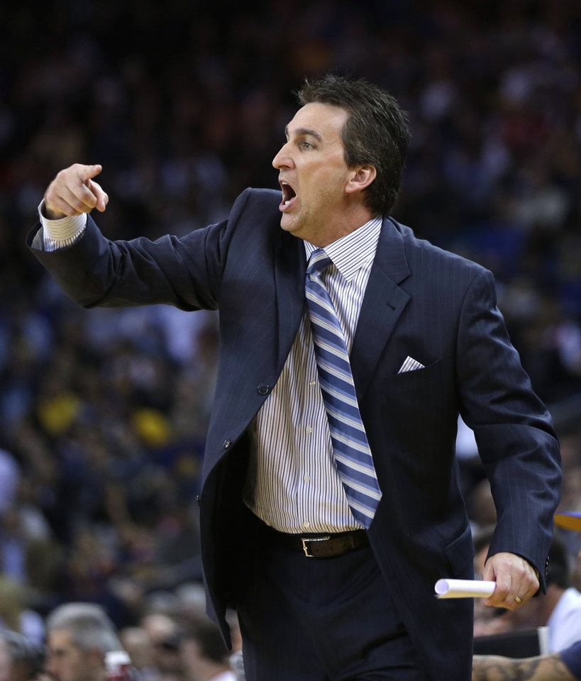 Los Angeles Clippers coach Vinny Del Negro makes a point to his players during the first half of an NBA basketball game against the Golden State Warriors in Oakland, Calif., Monday, Jan. 21, 2013. (AP Photo/Marcio Jose Sanchez)
