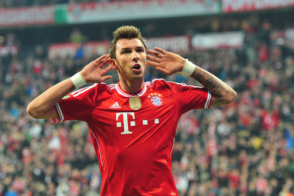 Photo - Munich's Mario Mandzukic of Croatia celebrates after scoring during the German soccer cup (DFB Pokal) semifinal soccer match between FC Bayern Munich and FC Kaiserslautern in the Allianz Arena in Munich, Germany, on Wednesday, April 16. 2014. (AP Photo/Kerstin Joensson)