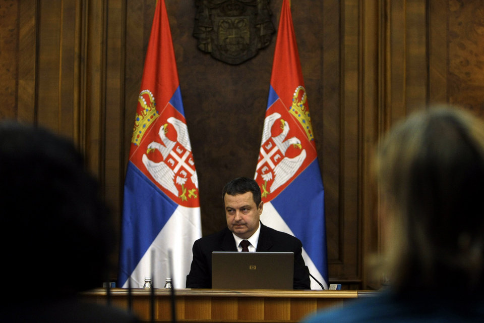 Photo - Ivica Dacic, the Serbian Prime Minister, center, presides over a session of the Serbian government in Belgrade, Serbia, Monday, April 22, 2013. The Serbian government on Monday approved a potentially landmark agreement to normalize relations with breakaway Kosovo that could end years of tensions and put the Balkan rivals on a path to European Union membership. (AP Photo/ Marko Drobnjakovic)