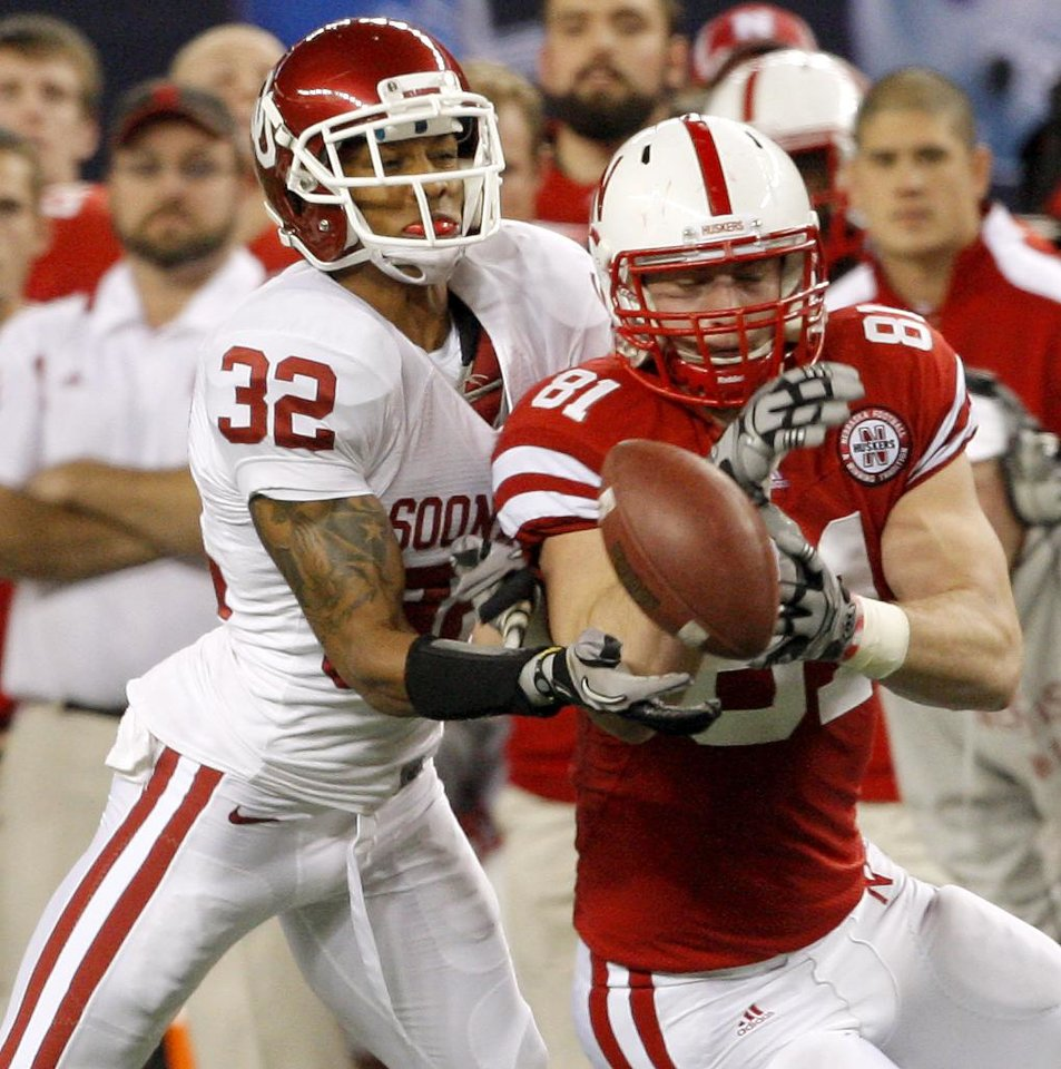 Photo - OU's Jamell Fleming breaks up a pass intended for Nebraska's Ben Cotton during the Big 12 football championship game between the University of Oklahoma Sooners (OU) and the University of Nebraska Cornhuskers (NU) at Cowboys Stadium on Saturday, Dec. 4, 2010, in Arlington, Texas.  Photo by Bryan Terry, The Oklahoman