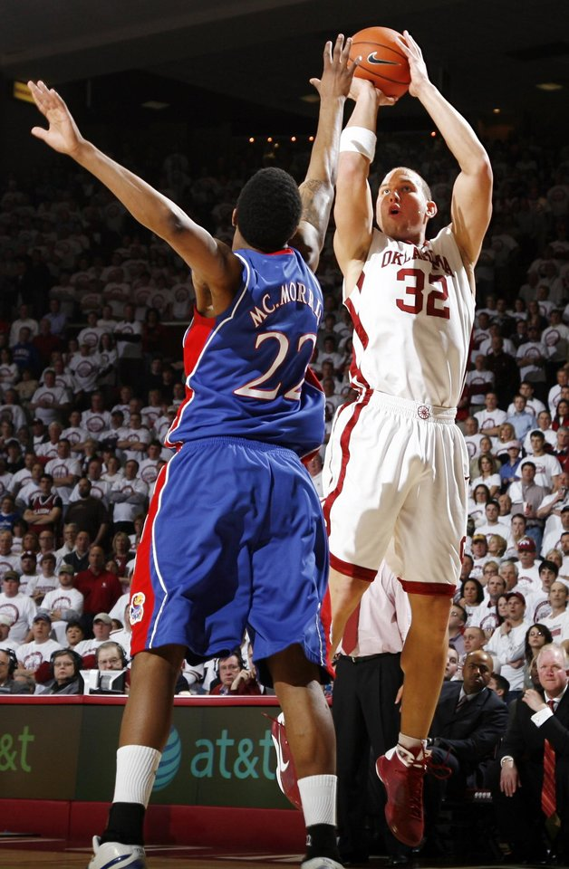 Photo - OU's Taylor Griffin (32) takes a shot over KU's Marcus Morris (22) in the second half of the men's college basketball game between Kansas and Oklahoma at the Lloyd Noble Center in Norman, Okla., Monday, February 23, 2009. KU won, 87-78. BY NATE BILLINGS, THE OKLAHOMAN