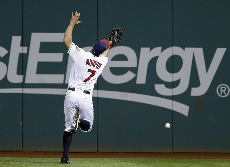 Photo - Cleveland Indians right fielder David Murphy can't catch a triple by Cincinnati Reds' Kris Negron to drive in two runs in the ninth inning of a baseball game Tuesday, Aug. 5, 2014, in Cleveland. Cincinnati won 9-2. (AP Photo/Mark Duncan)