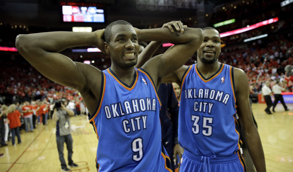 Oklahoma City Thunder's Serge Ibaka (9) and Kevin Durant (35) walks off the court after losing to the Houston Rockets in Game 4 in a first-round NBA basketball playoff series Monday, April 29, 2013, in Houston. The Rockets beat the Thunder 105-103. (AP Photo/David J. Phillip)
