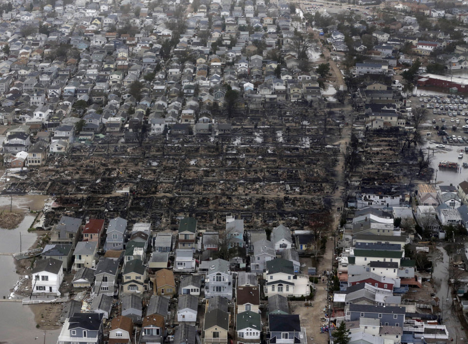 Photo -   This aerial photo shows burned-out homes in the Breezy Point section of the Queens borough New York after a fire on Tuesday, Oct. 30, 2012. The tiny beachfront neighborhood told to evacuate before Sandy hit New York burned down as it was inundated by floodwaters, transforming a quaint corner of the Rockaways into a smoke-filled debris field. (AP Photo/Mike Groll)