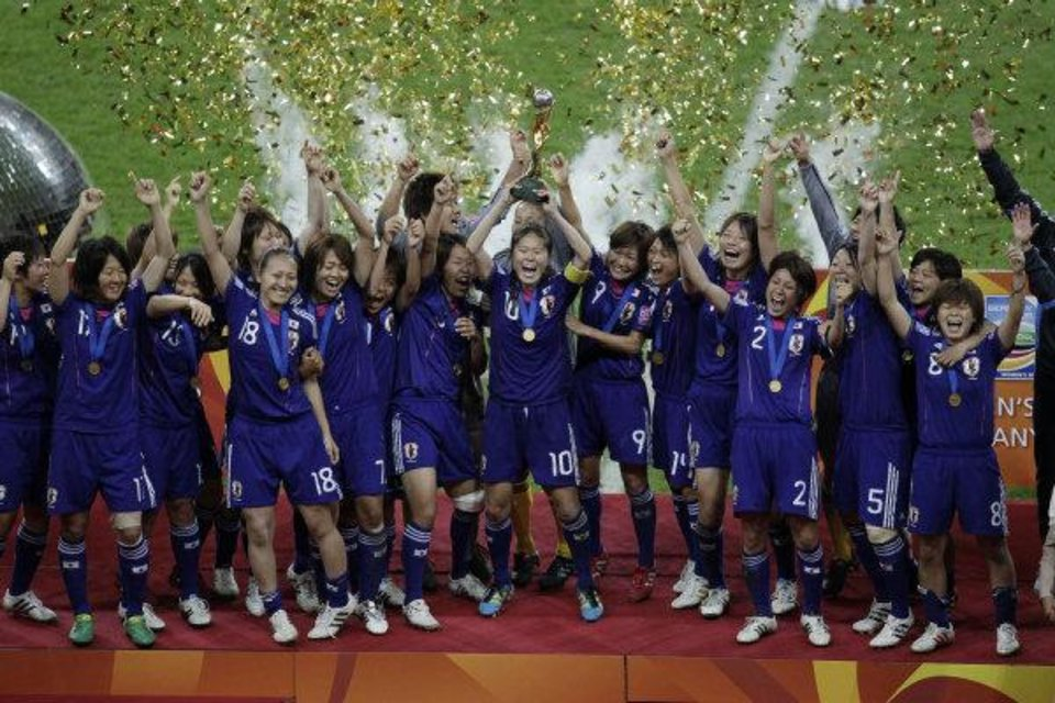 Photo - Japan players lift the trophy in celebration after the final match between Japan and the United States at the Women's Soccer World Cup in Frankfurt, Germany, Sunday, July 17, 2011. (AP Photo/Michael Sohn) ORG XMIT: WWC264