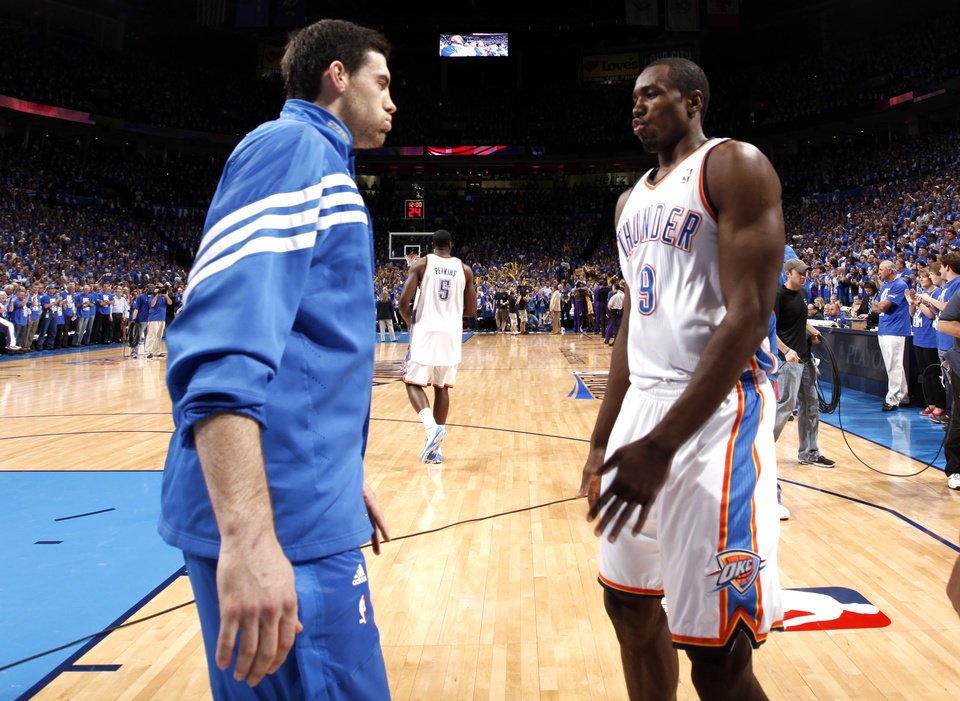 LOS ANGELES LAKERS / NBA BASKETBALL: Oklahoma City's Nick Collison (4) and Oklahoma City's Serge Ibaka (9) interact before Game 1 in the second round of the NBA playoffs between the Oklahoma City Thunder and the L.A. Lakers at Chesapeake Energy Arena in Oklahoma City, Monday, May 14, 2012. Photo by Sarah Phipps, The Oklahoman