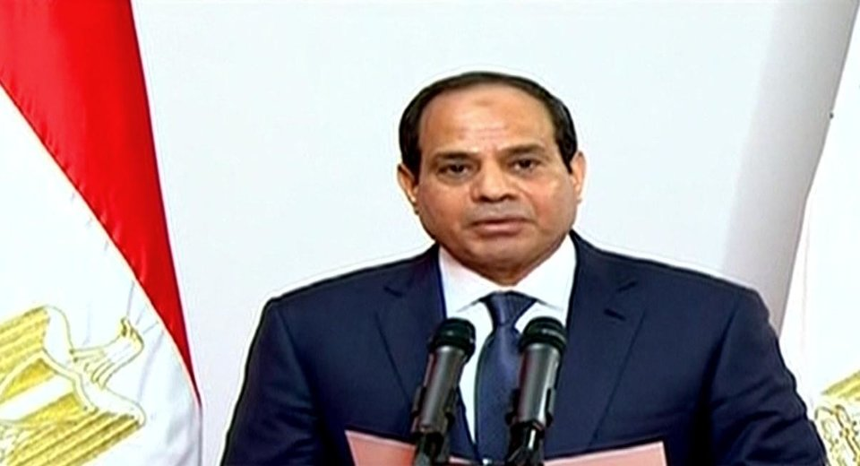 Photo - This image made from Egyptian State Television shows, Egyptian President Abdel-Fattah el-Sissi, gives a speech at the Supreme Constitutional Court in Cairo, Egypt, Sunday, June 8, 2014. El-Sissi's inauguration Sunday comes less than a year after the 59-year-old career infantry officer ousted the country's first freely elected president, the Islamist Mohammed Morsi, following days of mass protests by Egyptians demanding he step down. (AP Photo/Egyptian State Television)