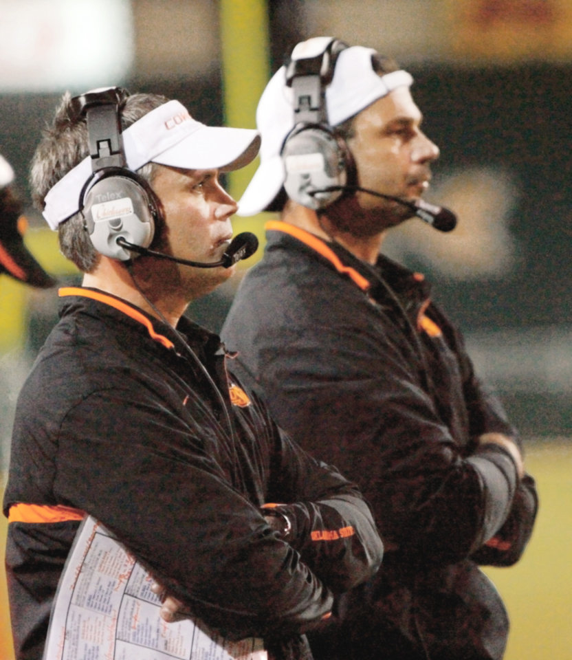 Photo - Mike Gundy must fill the position of defensive coordinator Tim Beckman, left, but he may do well to add another defensive coach to his staff.  PHOTO BY MATT STRASEN, THE OKLAHOMAN ARCHIVE